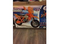 2 12v injusa cross motorbikes,1 brand new in box,1built,new charger in box will charge both