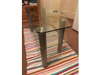 Glass television stand. Perfect condition. 100cm long and 46cm deep at widest point. Clear glass.