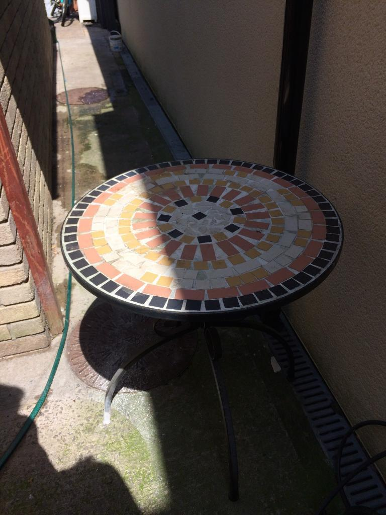 Very solid tiled garden table