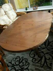 Ducal drop leafed table and 6 chairs.