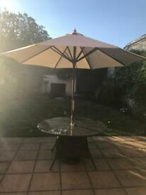 Rattan table and parasol