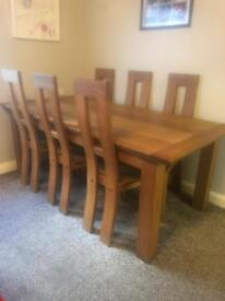Solid oak table and 6 chairs very heavy