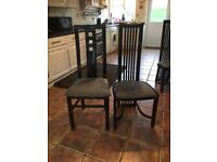 Large Black extendable dining table and six chairs good condition