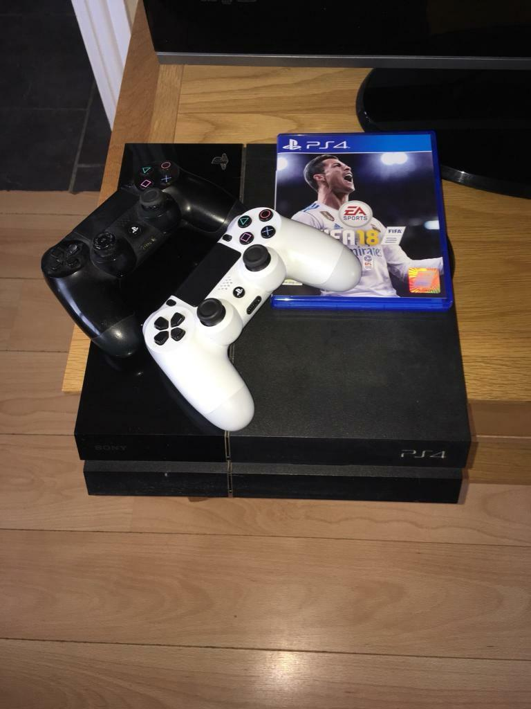 PlayStation 4 with 2 controls and Fifa 18