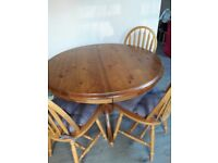 For sale - extendable dining table seats 6 + three chairs