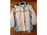 Girls ski jacket. Age 14 blue/ cream. Detachable hood. Exc condition. Collect from Findern nr Derby