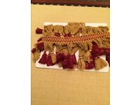 Fantastic red and gold bullion fringing. Never been used. Approx 2 metres.