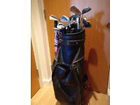 Golf clubs, bag, umbrella