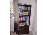 Dark wood bookcase with 4 shelves and 4 drawers for DVD/CD storage