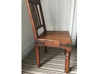 Dining chairs,solid,hard wood, with metal trim.