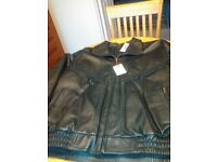 Brand new man's black leather jacket. Size large, labels still attached. Never worn. Perfect.