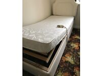 Electrically operated single bed with headboard