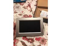 Brand new 7 inch digital photo frame with 8gb memory card