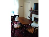 Lovely extending dining table and chairs. Period style. Good condition.