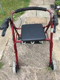 FOLDING WALKER WITH A SEAT with breaks