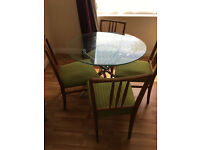 Glass round table and 6 chairs