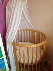 Stokke cot and bed for 0 to 3 year old. Natural colour.