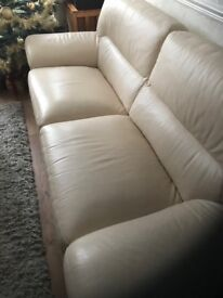 Leather couches,cream in good condition,hardly used