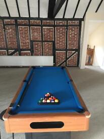 Lovely pool table. All balls triangle and cue included!