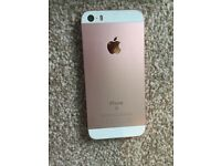 iPhone SE Rose Gold boxed with earphones and charger