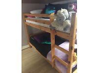 Wooden kids bunk bed with mattresses