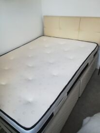 Double divan bed with padded headboard