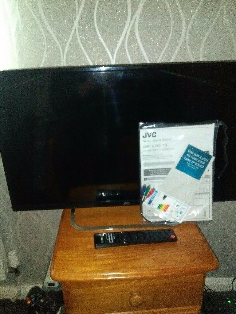 Led TV 32 in JVC black as new with remote HDMI free view and comes with stand and TV manual