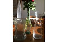 3 glass vases, one can be used to serve water