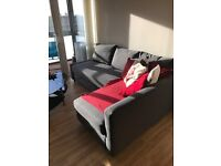 IKEA corner sofa bed. Double bed with faux leather head board