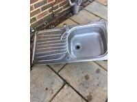 Stainless steel sink with tap..