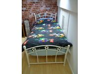 SINGLE DIVAN BED. METAL HEAD AND FOOT BOARD. WITH FOOTBALL MOTIVES WITH MATTRESS