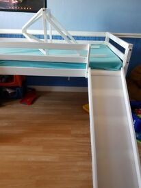Kids bed with a slide