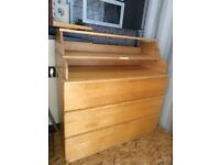 Fold-away baby-changing table on top of chest of drawers