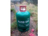 Full bottle of butane patio gas