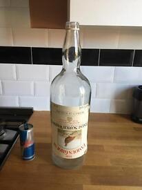Vintage old coin jar whisky bottle