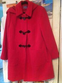 Ladies red duffle coat.