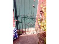 Used Black short Iron garden gate..