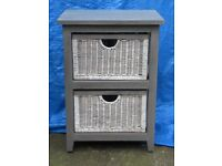 Grey wooden bed side table with white wicker drawers, chest of drawers
