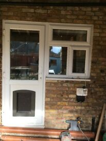 UPVC Door (used) with a dog flap in good condition