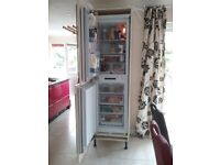 Hotpoint integrated fridge freezer and cupboard.