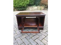 Dark wood TV cabinet with glazed door - excellent condition