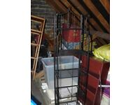 Lovely ornate 4 tier shelving unit. Black wrought iron effect. Can collapse for storage.