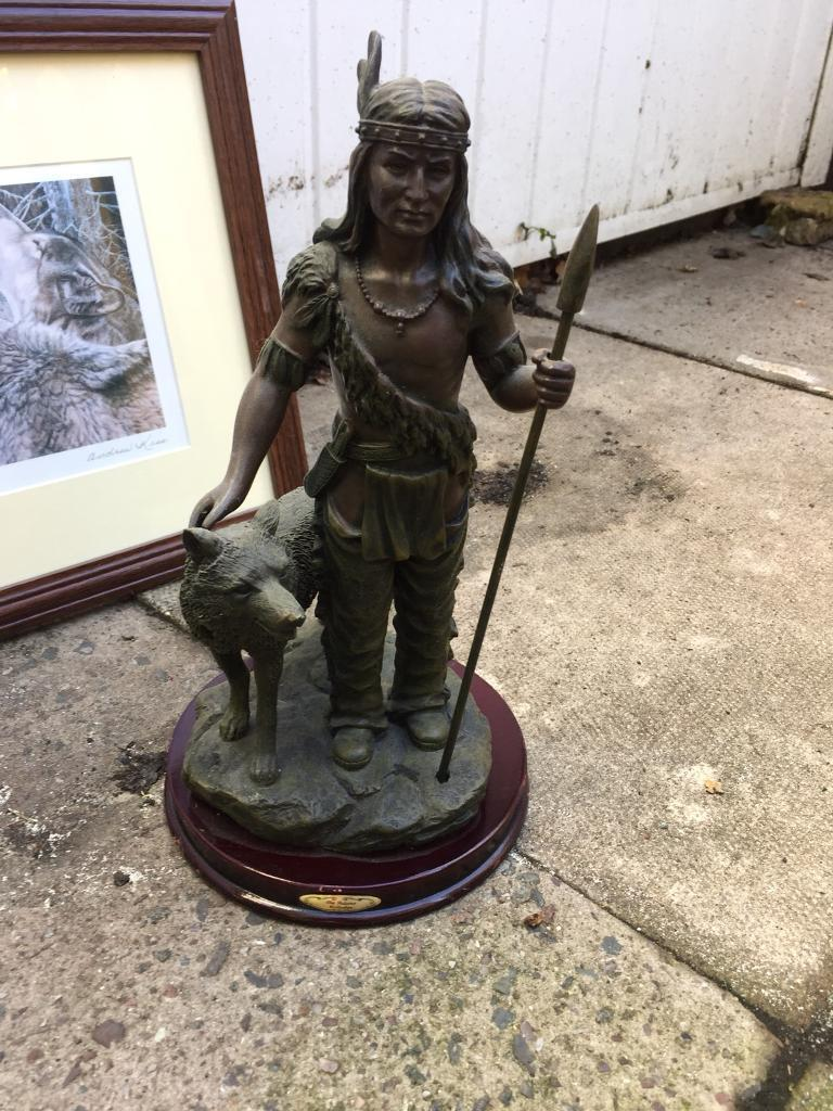 Indian/wolf statue