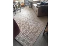Handmade luxurious neutral coloured rug