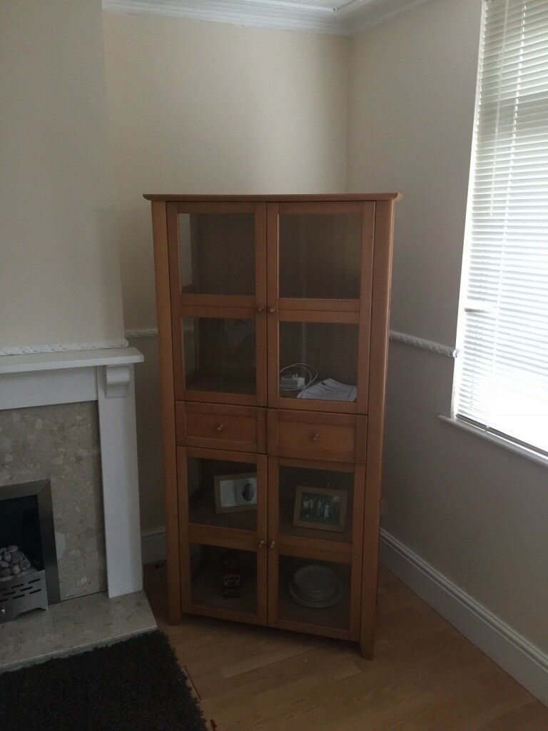 Display cabinet with 2 draws. Excellent condition. Beech wood effect, glass.