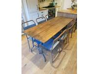 Grey Vintage pine trestle table and 6 industrial stacking school chairs