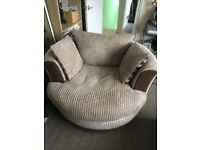 Swivel arm chair in good condition with puffy cosy