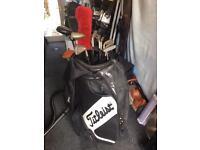 Titleist golf bag with hogan clubs
