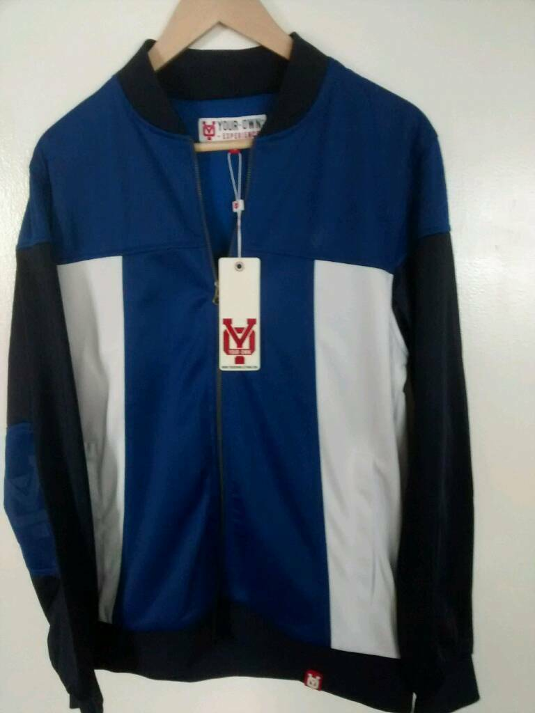 Tracksuit top in bluein Seaton Sluice, Tyne and WearGumtree - Brand new top in blue,large size with logos,online retails for ,£65,other styles and colours available