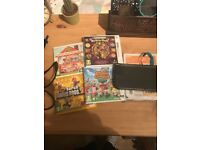 Nintendo 3DS XL with charger and 4 games